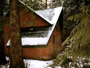 A Frame cabin with snow on it